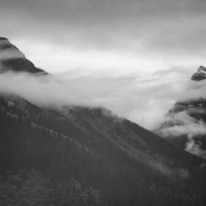 Mountain partially covered with clouds-Glacier National Park-Montana