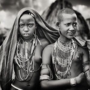 Karo girls sharing a scarf
